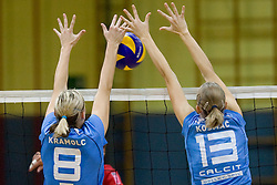 Petra Kramolc and Jelena Strel Kosmac in block during volleyball match between Calcit Volleyball and A. Linz-Steg in Mevza league on October 23, 2010 at Sport Halli, Kamnik, Slovenia. (Photo By Matic Klansek Velej / Sportida.com)