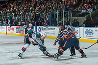 KELOWNA, CANADA - MARCH 31: Linesman Kevin Crowell drops the puck between Calvin Thurkauf #27 of the Kelowna Rockets and Lane Bauer #25 of the Kamloops Blazers on March 31, 2017 at Prospera Place in Kelowna, British Columbia, Canada.  (Photo by Marissa Baecker/Shoot the Breeze)  *** Local Caption ***