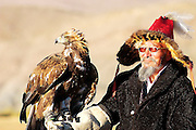 An eagle hunter prepares his eagle for the annual Eagle Hunting Festival that celebrates Kazakh culture, Bayan Olgi, Mongolia, Sept 18, 2004.  Kazakhs have hunted with eagles for centuries.  The Eagle Hunting Festival has revived Kazakh culture which was surpressed under Soviet rule.