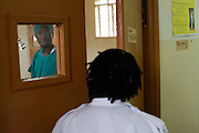 Doctor Ivan Nyenje speaking to the nurse in the main theatre at Kasangati Health Centre in Uganda.