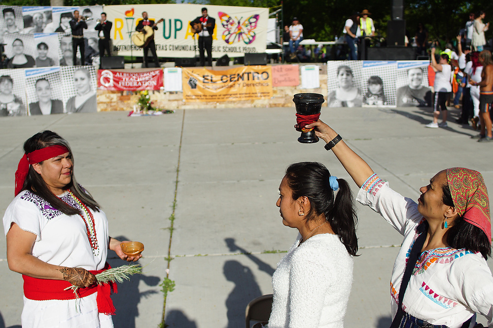 apl050117e/ASECTION/pierre-louis/JOURNAL 050117<br /> Traditional healers Alma Rosa Silva Banuelos,, left and Dina Barajas,,right  perform  a cleansing session on Lucila Romero ,, during the May Day Rise Up ABQ rally held at Tiguex Park.Photographed on Monday May 1 2017. .Adolphe Pierre-Louis/JOURNAL