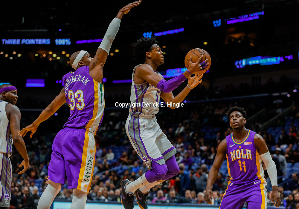 Jan 30, 2018; New Orleans, LA, USA; Sacramento Kings guard De'Aaron Fox (5) shoots over New Orleans Pelicans forward Dante Cunningham (33) during the first quarter at the Smoothie King Center. Mandatory Credit: Derick E. Hingle-USA TODAY Sports