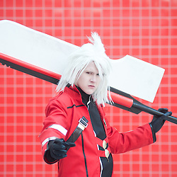 London, UK - 26 May 2013: James Davies dressed as Ragna from the videogame Blazblue poses for a picture during the London Comic Con 2013 at Excel London. London Comic Con is the UK's largest event dedicated to pop culture attracting thousands of artists, celebrities and fans of comic books, animes and movie memorabilia.