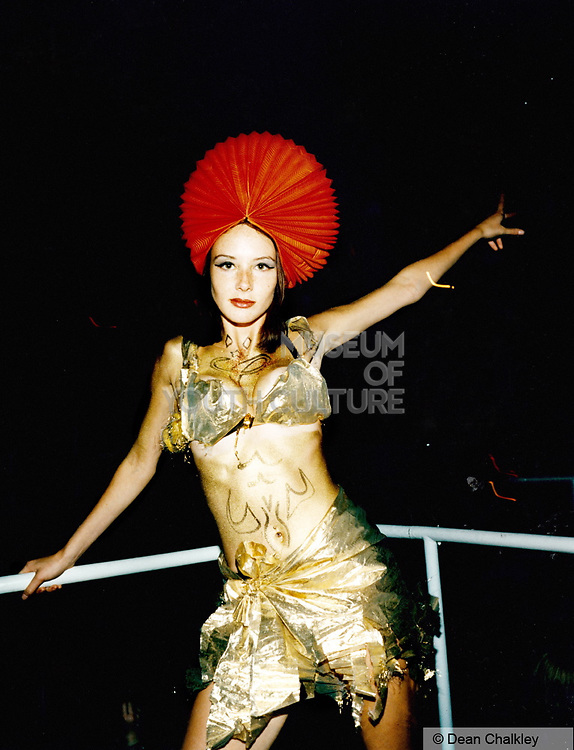 Girl dressed up in a customised gold clubbing outfit, Ibiza 1999