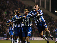 Photo: Jed Wee.<br /> Wigan Athletic v Manchester United. The Barclays Premiership. 06/03/2006.<br /> <br /> Wigan rush in to congratulate goal scorer Paul Scharner.
