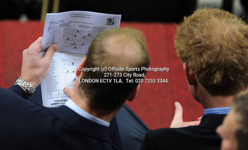 18/06/2010 World Cup. England v Algeria.<br /> Princes William and Harry try to figure out England's tactical line up.<br /> Photo: Mark Leech.