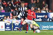 Grimsby Town midfielder Jake Hessenthaler(7) and Crewe Alexandra's Tom Lowery(16) during the EFL Sky Bet League 2 match between Grimsby Town FC and Crewe Alexandra at Blundell Park, Grimsby, United Kingdom on 4 May 2019.