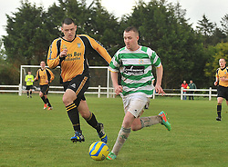 Castlebar Celtic's Ioseph O'Reilly takes on Ballinasloe's Kenneth Kenny Connaught Cup Final, Milebush Castlebar.<br /> Pic Conor McKeown