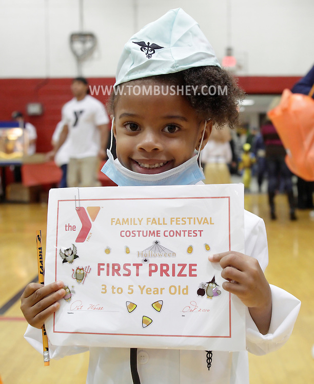 Middletown, New York - A little girl wearing a doctor's costume holds the prize she won at the Family Fall Festival at the Middletown YMCA on Oct. 23, 2010.