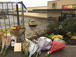 Floral tributes by the Aldi in Skipton, North Yorkshire following the stabbing of supermarket worker Jodie Willsher, 30 on Thursday.