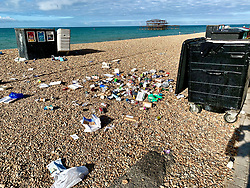 © Licensed to London News Pictures. 02/08/2020. Brighton, UK. Council staff are cleaning up the beach in Brighton And Hove as tons of rubbish was left by revellers on Saturday. Photo credit: Hugo Michiels/LNP