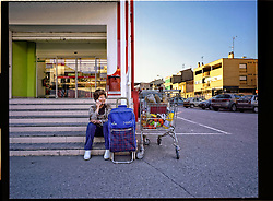 2012.Binefar, Huesca, Spain.A woman in a supermarket with the shopping cart.© Carmen Secanella