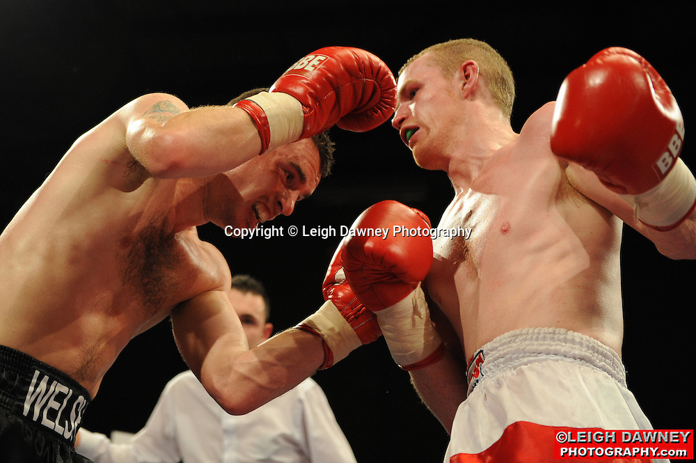 Martin Welsh (black shorts) defeats Willliam Warburton at Gorsebrook Leisure Centre Dagenham on 14th May 2010. Frank Maloney Promotions. Photo credit: © Leigh Dawney