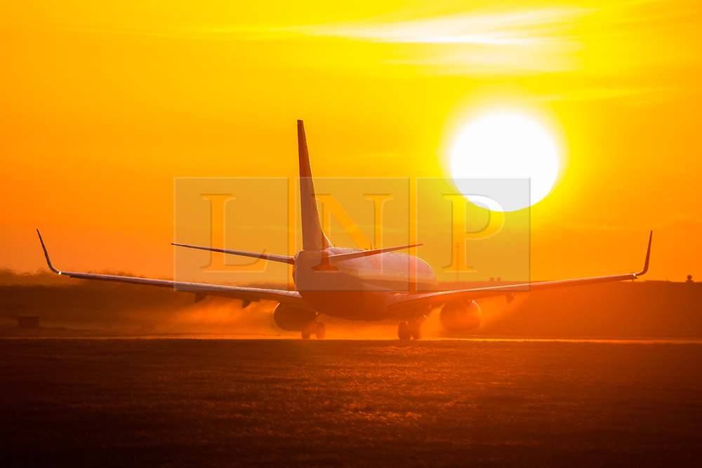 © Licensed to London News Pictures. 13/01/2020. Leeds UK. A Jet2 aircraft heading to Tenerife on the runway as the sun rises this morning at Leeds Bradford Airport in Yorkshire. Photo credit: Andrew McCaren/LNP