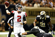 NEW ORLEANS, LA - NOVEMBER 11:  Matt Ryan #2 of the Atlanta Falcons throws a pass under pressure against the New Orleans Saints at Mercedes-Benz Superdome on November 11, 2012 in New Orleans, Louisiana.  The Saints defeated the Falcons 31-27.  (Photo by Wesley Hitt/Getty Images) *** Local Caption *** Matt Ryan