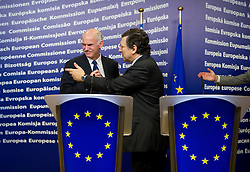 "George Papandreou, Greece's prime minister, left, and Jose Manuel Barroso, president of the European Commission, depart after a press briefing that followed their meeting at the European Union Commission headquarters in Brussels, Belgium, on Wednesday, March 17, 2010. German Chancellor Angela Merkel said the European Union must avoid any ""overly hasty"" aid pledge to Greece. (Photo © Jock Fistick)"