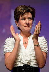 ©  London News Pictures. 17/09/2016. Bournemouth, UK. Party leader DIANE JAMES joins UKIP supporters as they give a minutes applause in the memory of UKIP campaigners who have died, at Day 2 of the 2016 UKIP Autumn Conference, held at the Bournemouth International Centre in Bournemouth, Dorset. On Friday, the party elected Diane James as their new leader, following Nigel Farage resignation after the UK voted to leave the EU in a referendum..  Photo credit: Ben Cawthra/LNP