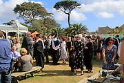 Garden party at graduation ceremony, University of Falmouth, Cornwall, England, UK