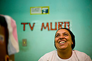 Sabara_MG, Brasil...A TV Muro e uma pequena organizacao produtora de televisao brasileira localizada na cidade de Sabara. E intitulada a menor rede de televisao do mundo. Na foto a esposa do criador da TV Francisco Dario dos Santos, o Chiquinho...The TV Muro is a small Brazilian television network, located in Sabara. Its the smallest TV in the world. Na foto the wife of the creator of tv Francisco Dario dos Santos, Chiquinho...Foto: JOAO MARCOS ROSA / NITRO
