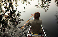 Sunrise paddle on a cold grey morning in the swamps of Lake Maurepas in south Louisiana.