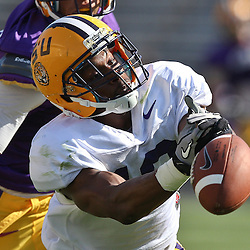 April 9, 2011; Baton Rouge, LA, USA;  LSU Tigers wide receiver Russell Shepard (10) has the ball slip through his fingers as cornerback Ryan St. Julien defends during the 2011 Spring Game at Tiger Stadium.   Mandatory Credit: Derick E. Hingle