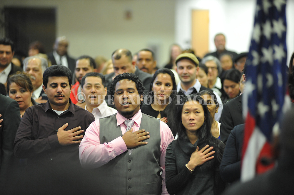 New citizens recite the Pledge of Allegiance during a Naturalization Ceremony in U.S. District Court for the Northern District of Mississippi, at Oxford High School in Oxford, Miss. on Tuesday, November 18, 2014. The ceremony was the first the court has ever held at the school.