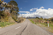 Road from Stratford running across to the base of Mt Taranaki, New Zealand