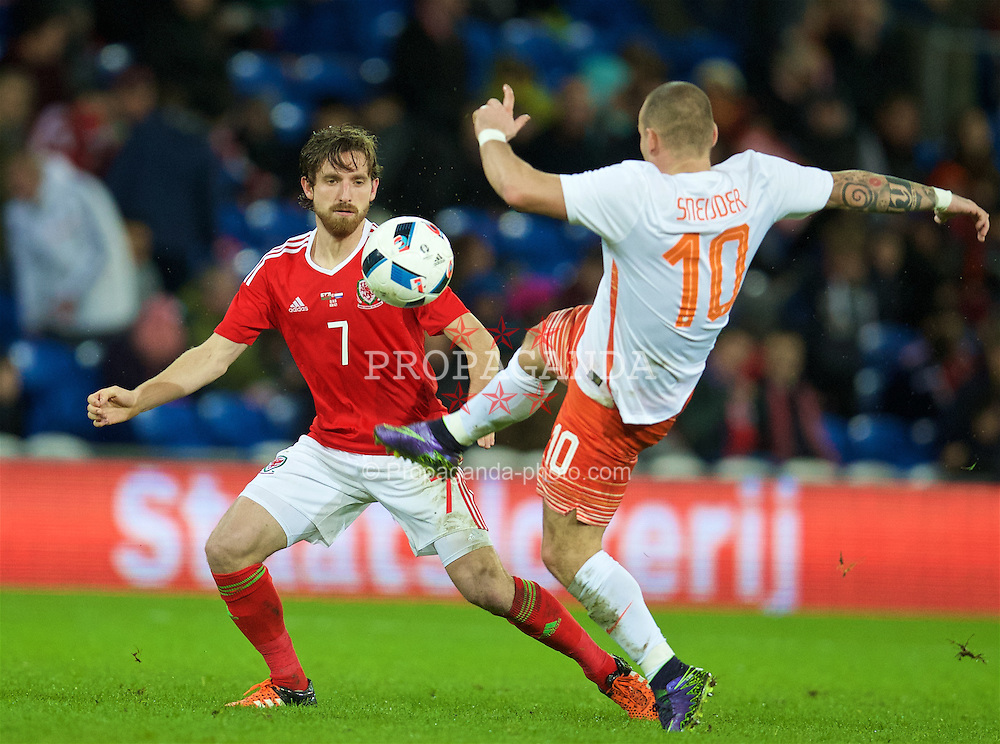 CARDIFF, WALES - Friday, November 13, 2015: Wales' Joe Allen in action against the Netherlands' Wesley Sneijder during the International Friendly match at the Cardiff City Stadium. (Pic by David Rawcliffe/Propaganda)
