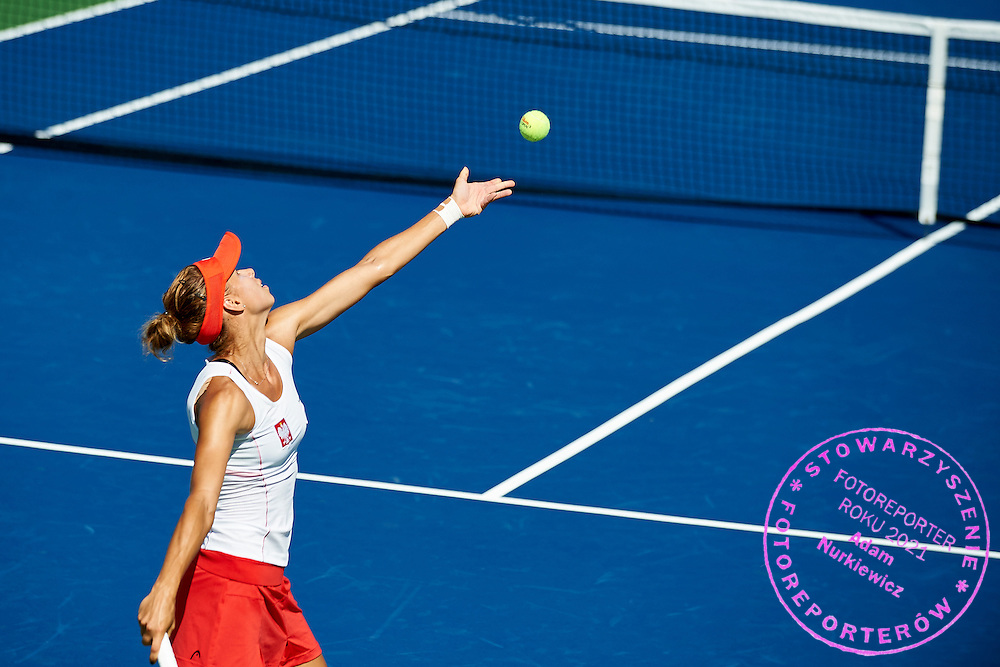 KAILUA KONA, USA - 2016 FEBRUARY 06: Magda Linette of Poland competes at women's singles during the Fed Cup World Group II 1st round tennis match between USA and Poland on February 06, 2016 at Holua Tennis Center in Kailua Kona, USA.<br /> <br /> Picture also available in RAW (NEF) or TIFF format on special request.<br /> <br /> Any editorial, commercial or promotional use requires written permission from the author of image.<br /> <br /> Adam Nurkiewicz declares that he has no rights to the image of people at the photographs of his authorship.<br /> <br /> Mandatory credit:<br /> Photo by &copy; Adam Nurkiewicz / Mediasport