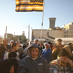 Feb 09, 2010; New Orleans, LA, USA; New Orleans Saints fans celebrate as a black and gold flag flies behind fan during the Super Bowl celebration parade for the New Orleans Saints 31-17 victory over the Indianapolis Colts in Super Bowl XLIV as the parade passed through the downtown streets of New Orleans, Louisiana.  Mandatory Credit: Derick E. Hingle-US-PRESSWIRE.
