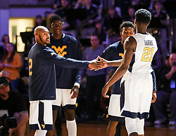 Dec 16, 2017; Morgantown, WV, USA; West Virginia Mountaineers guard Jevon Carter (2) and West Virginia Mountaineers forward Wesley Harris (21) are announced before the game against the Wheeling Jesuit Cardinals at WVU Coliseum. Mandatory Credit: Ben Queen-USA TODAY Sports