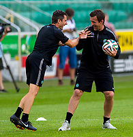 29/07/14<br /> CELTIC TRAINING<br /> PEPSI ARENA - WARSAW<br /> All smiles from Celtic manager Ronny Deila (right) and assistant John Collins as they take training in Warsaw