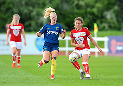 Alisha Lehmann competes with Ella Rutherford of Bristol City- Mandatory by-line: Nizaam Jones/JMP - 28/04/2019 - FOOTBALL - Stoke Gifford Stadium - Bristol, England - Bristol City Women v West Ham United Women - FA Women's Super League 1