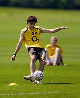 Photo: Richard Lane.<br />Arsenal Training Session. The Barclays Premiership. 11/05/2006.<br />Francesc Fabregas practices shooting during training.