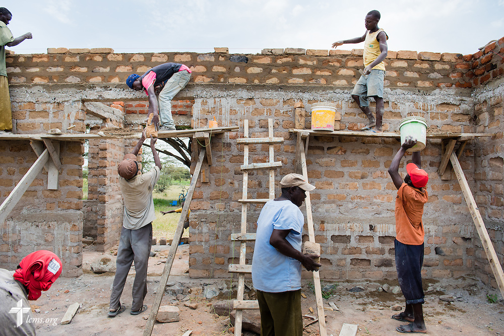 Church members construct the Magagi Lutheran Church of the Evangelical Lutheran Church in Tanzania – South-East of Lake Victoria Diocese (ELCT-SELVD) on Friday, March 13, 2015, in Shinyanga region, Tanzania. Funds are needed to purchase a tin roof for the church. LCMS Communications/Erik M. Lunsford