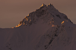 Chunekukleik Mountain, a peak in the Takhin Ridge is bathed in morning sunrise light in this view seen from the Alaska Chilkat Bald Eagle Preserve near Haines, Alaska.