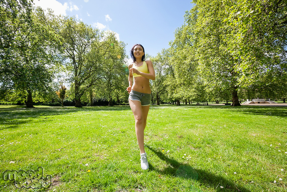 Full length of fit woman jogging at park