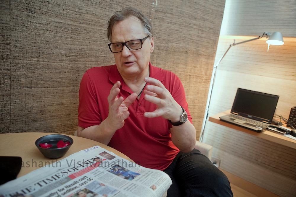 Professor, Juha Hernesniemi , speaks during an interview at his hotell in Mumbai, India, on Sunday, April 17, 2011. Photographer: Prashanth Vishwanathan/HELSINGIN SANOMAT