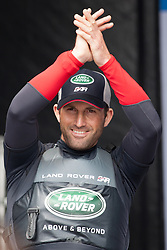 July 24, 2016 - Portsmouth, Hampshire, United Kingdom - Portsmouth, United Kingdom.  Sir Ben Ainslie prior to the second day of racing for the America's Cup World Series (ACWS) held in Portsmouth this weekend, 22nd-24th July 2016. British Olympic sailing legend, Sir Ben Ainslie, is leading his all-British team, Land Rover BAR, against other teams in a battle to qualify for a place in the two team America's Cup final, to be held in Bermuda in 2017. (Credit Image: © Rob Arnold/London News Pictures via ZUMA Wire)