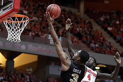 """20 March 2017:  A.J. Davis passes by Daouda """"David"""" Ndiaye (4) for a layup during a College NIT (National Invitational Tournament) 2nd round mens basketball game between the UCF (University of Central Florida) Knights and Illinois State Redbirds in  Redbird Arena, Normal IL"""