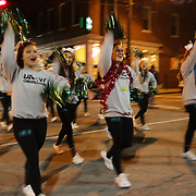 UNCW cheerleaders participate in the 12th Annual Wilmington Holiday Parade Sunday December 7, 2014 in Wilmington, N.C. (Jason A. Frizzelle)
