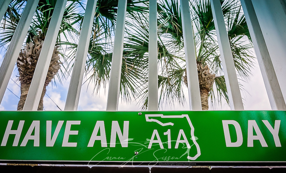 "A sign exhorts customers to ""Have an A1A Day"" at Sunset Grille, March 19, 2016, in St. Augustine, Florida. The restaurant opened in 1990 and offers a laidback, Key West atmosphere. Signs throughout the building refer to Florida state road A1A, where the restaurant is located. The road runs along the Atlantic Ocean, from Key West to Fernandina Beach, Florida. The historic highway, which is more than 338 miles long, is a designated National Scenic Byway and holds an important place in Florida beach culture. Sunset Grille has popularized the name by using #SomewhereOnA1A, #A1ALife, and #HaveAnA1ADay on social media. (Photo by Carmen K. Sisson/Cloudybright)"