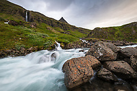 Waterfall and river in Mjóifjörður, East fiords of Iceland.