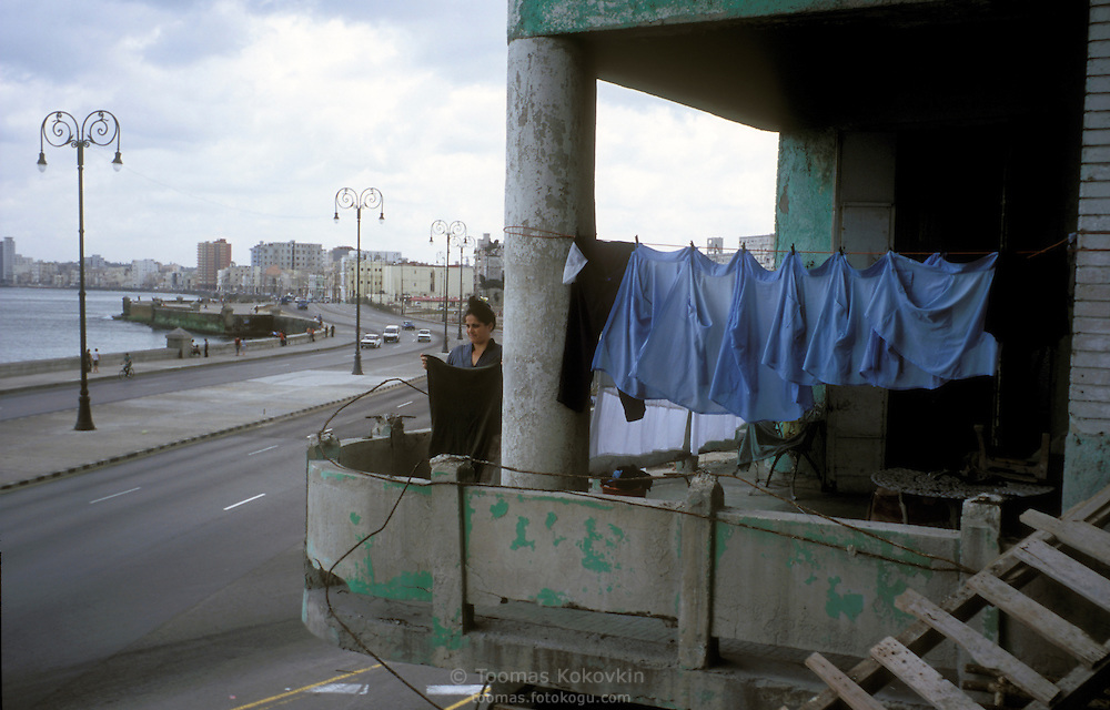 Scirts drying on a balcony of a deteriorated former colonial apartment building at Malecon, embankment in Habana, Cuba