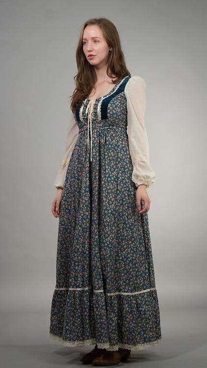 Female model posing in a western country dress.