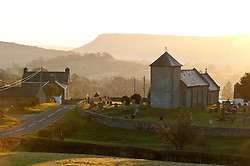 © Licensed to London News Pictures. 05/05/2016. Llandewi'r Cwm, Powys, Wales, UK. The sun rises over St David's Church in the tiny hamlet of Llandewi'r Cwm in Powys, Mid Wales, UK. Photo credit: Graham M. Lawrence/LNP