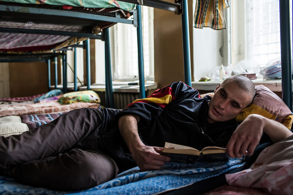 YEKATERINBURG, RUSSIA - OCTOBER 16: Alexei, a 29-year-old from Chelyabinsk who is addicted to a methamphetamines, reads a book during the first stage of his treatment for drug addiction at City Without Drugs on October 16, 2013 in Yekaterinburg, Russia. City Without Drugs is a well-known narcotics treatment program in Russia founded by Yevgeny Roizman, who was elected mayor of Yekaterinburg in September 2013. (Photo by Brendan Hoffman/Getty Images) *** Local Caption ***