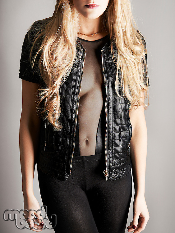 Blonde in sheer top and leather jacket