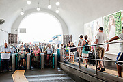 03 August 2017, Capri Italy - Hundrends tourists wait the entry to Funicolare at the ticket barrier.