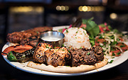 The Ottoman Platter, consisting of chicken and lamb shish, adana, and kofte kebab served with rice pilaf, yogurt sauce, pita bread and salad at Meze Mediterranean Cuisine in Sun Praire, WI on Thursday, May 2, 2019.
